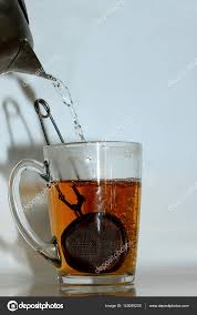 making tea with infuser stock photo