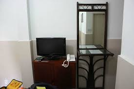 flat screen tv and mirror picture of