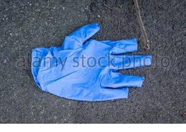 Used White Rubber Glove Being Littered On The Fence People Are Littering Their Gloves Coronavirus Pandemic Stock Photo Alamy
