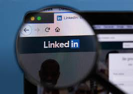 Linkedin logo on a computer screen with a magnifying glass… | Flickr