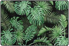 alaza tropical palm leaves area rug