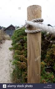 A Wooden Post Adn Rope Fence Mark Out A Pathway Through The Sand Stock Photo Alamy