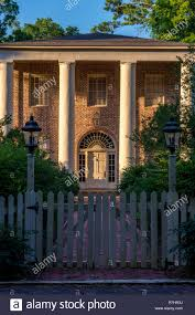 Brick House Picket Fence High Resolution Stock Photography And Images Alamy
