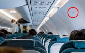The Secret Behind Those Little Triangle Stickers In Your Airplane Cabin Travel Leisure