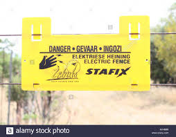 Electric Fence Danger Sign For Zebula Lodge Spa And Golf Estate Stock Photo Alamy
