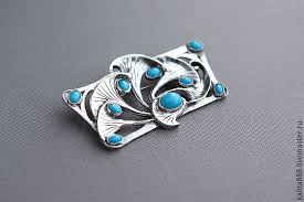 silver brooch pendant with turquoise
