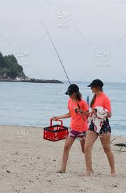 two s with fishing rods on the