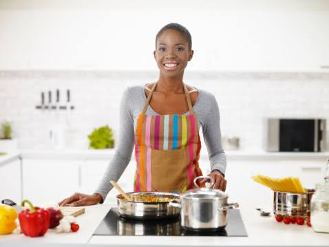 african young woman cooking