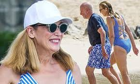 Jerry Hall, 62, displays her youthful physique in a striped ...