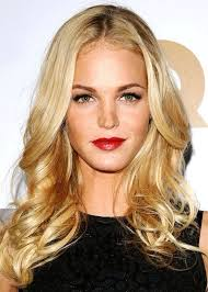golden blonde freckles dark eyebrows