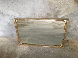 faux bamboo gilt metal framed mirror