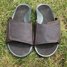 pair of mens brown leather slide