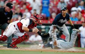Collision at Home: Atlanta Braves' Adonis Garcia, front right ...