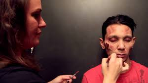 professional makeup artist does zombie