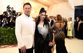 "Elon Musk says Grimes has ""much bigger role"" in caring for their son"