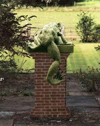 sculpture climbing frog bronze by
