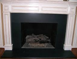 absolute black granite fireplace