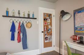 Boy Bedroom With Cork Board On Back Of Door Transitional Boy S Room