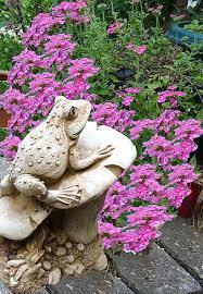 frog garden statue flowers nature