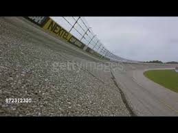 Wide Angle Of Nascar Racetrack Fence Barries Race Cars Speed Toward Camera Passing On Both Sides Youtube