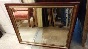 large cherry wood framed wall mirror