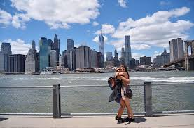Hd Wallpaper Photo Of Two Women Hugging Near Wire Fence Under Gray Clouds During Building Faraway From Empire State Building New York Wallpaper Flare