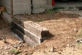 build a railroad tie retaining wall