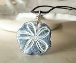 white flower polymer clay pendant