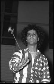 Abbie Hoffman in his American flag shirt, playing with a yo yo - Digital  Commonwealth