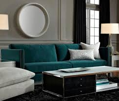 deep teal sofa is a gem against grey