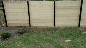 Check Out Our New Fence Design Contemporary Horizontal Plank Fence The American Fence Company