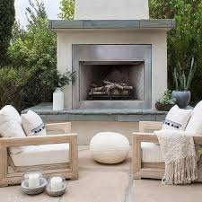 white stucco fireplace and hearth
