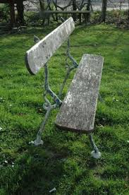 french wooden garden bench on cast iron
