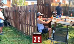Two Drinking Friends Convert Fence Panel Into Flip Down Bar After Their Local Pub Shut Amid Lockdown Daily Mail Online