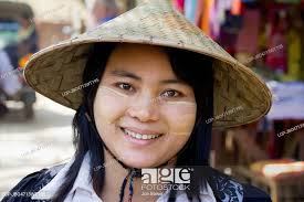 wearing conical straw hat