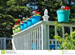 Colorful Flower Pots On A White Balcony Railing Stock Photo Image Of Colorful Blue 122659708