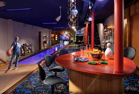 Bowling Alley Nyc Eclectic Basement And Black Counter Stool Black Pendant Light Bowling Bowling Balls Carpet Pattern Carpeted Floor Family Room Game Room Kids Room Orange Beam Orange Countertop Orange Post Wood