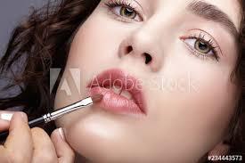 make up artist apply beauty makeup on