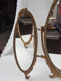 fold out oval mirror in gold coloured