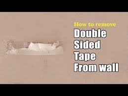 to remove double sided tape from wall