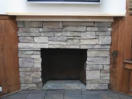 cover a brick fireplace with stone
