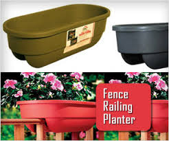 Grow Flowers In Planter Box Placed On Fence Railing