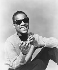 A young Stevie Wonder posed with his harmonica circa 1960. At 11-years-old,  Stevie began his singing career and auditioned at Motow… | Stevie wonder,  Stevie, Wonder