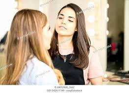 hispanic makeup artist stock photos and