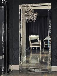 antique white mirror above the metal