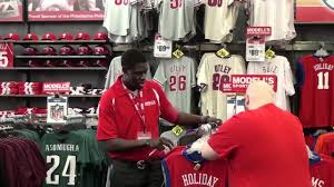 Jrue Holiday as Modell's Employee ...