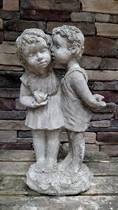 kissing girl garden statue