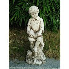 little boy reading garden statue