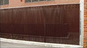 Chain Link With Brown Privacy Slats Mills Fence Co