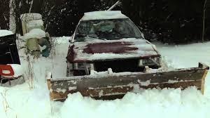 snow plow on a toyota corolla 4x4